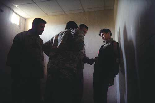 A Sunni man is detained by a Shiite-dominated army force at a JSS in the Mansour district of Baghdad.
