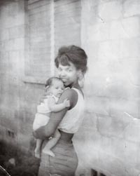 Woman Holding an Infant