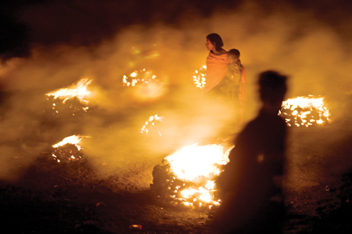 People burn coal in Bokahapadi Village, Jharia, Jharrkhand, India.