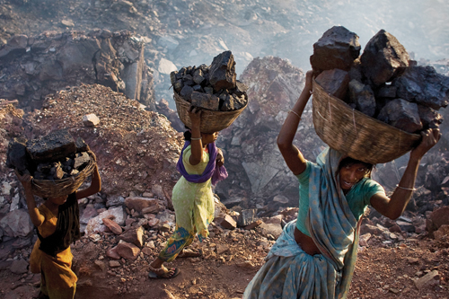 Women scavenge for coal illegally in Jharia.