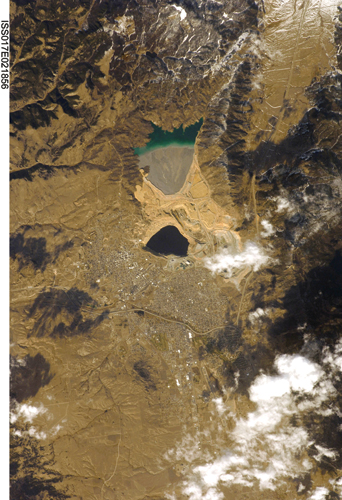 Overhead photo of the Berkeley Pit. Butte is immediately to the south and west; north of the Pit is Yankee Doodle Tailings Pond.