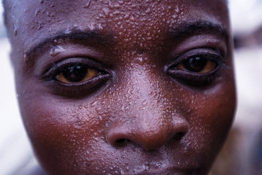 Sweat beads on the brow of one of the more than two thousand artisanal miners at Bisie, a cassiterite mine in the North Kivu province of the Democratic Republic of Congo