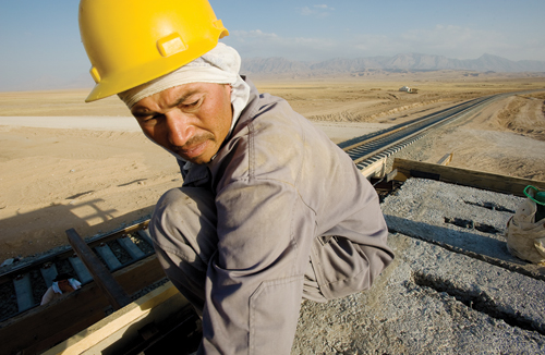 Uzbek workers build a signal station on the new railway spur between the northern Afghan city of Mazar-e-Sharif and Uzbekistan.