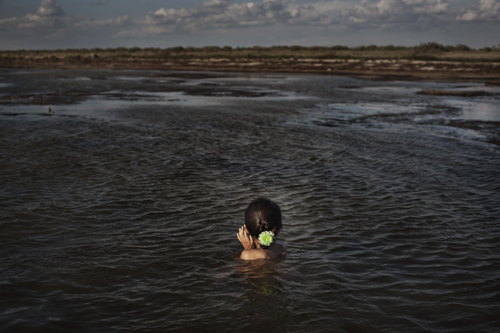 Seven-year-old Madina bathes in the Aral Sea near Tactubek.