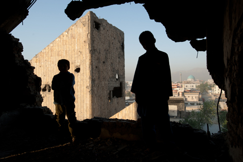 Sherifullah, eleven, and Abdel Basit, eight, stand on one of the ruined upper floors of the Russian Palace of Culture, which was heavily shelled during the mujahidin civil war.