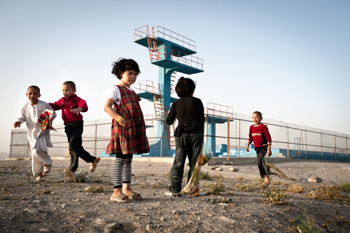 Children play atop Bibi Mahru Hill in central Kabul, next to an olympic swimming pool and platform diving boards constructed by the Soviets.