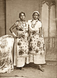 Two Coolie women in traditional dress.