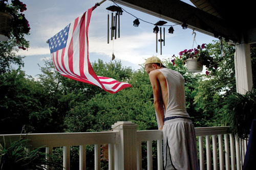 Cody Wymore, teenage son of Sergeant Tim Wymore, on the deck of the family home in St. Charles, Missouri.
