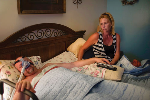 Shanna Wymore puts Tim to bed with an oxygen mask to help him breathe while sleeping.