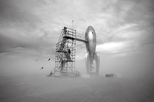 A surreal rocket and scaffold at the Burning Man festival in Nevada