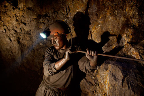 Santiago Qispe, twenty-nine, hollows out a hole for dynamite in Pairaviri, the largest mine in Potosí, Bolivia.
