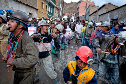 Miners march down from Cerro Rico into the city during the annual Miners' Carnival celebrating their history and culture.