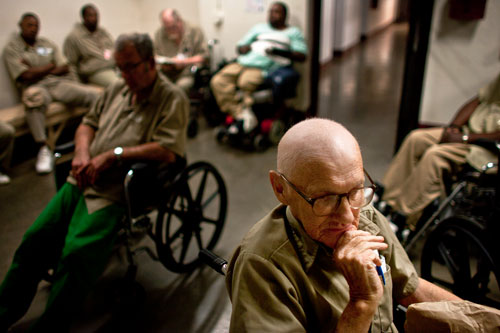 Roy Dunn, sixty-three, waits in a holding  area at the Kentucky State Reformatory in La Grange for his ride home