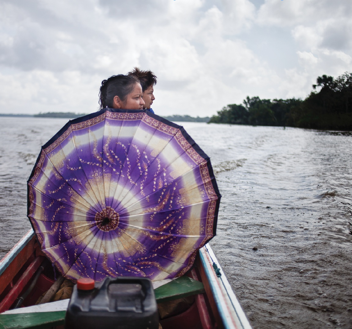 Lilia and her son Helielder on their boat along the Amazon. Lilia moved to Jararaca when she married. Her husband is the 