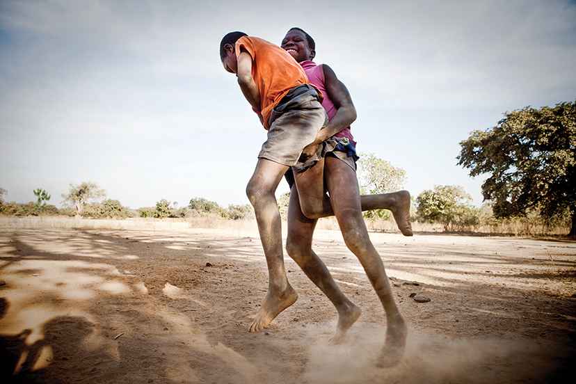 Young boys in the village of Karantaba wrestling in a traditional Gambian style. Karantaba was where, in 1791, Scottish explorer Mungo Park set out on his epic journey in search of the Niger River. below: Children in the village of Mandinari.