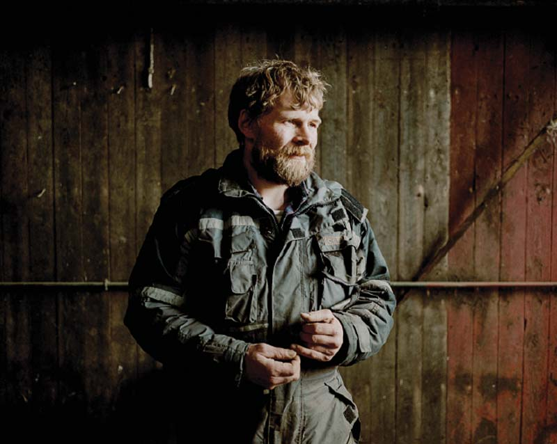 Sigert Patursson, one of the last Faroese farmers, in his barn outside of the town of Hoyvík.