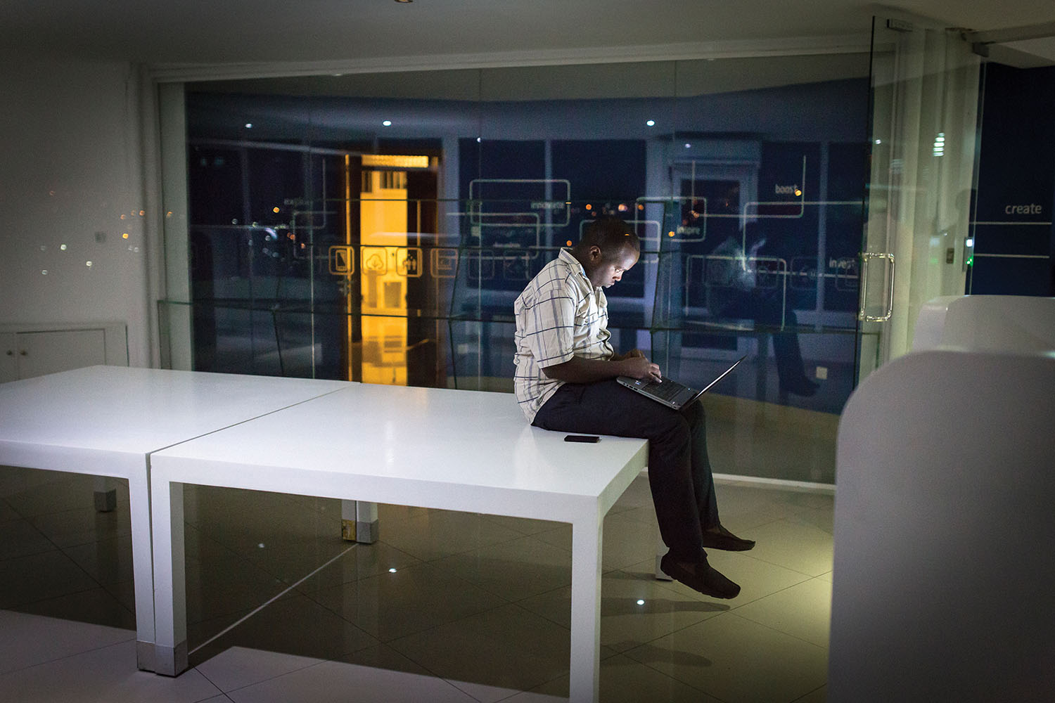Timothee Mwizihire works late at the Kigali tech-incubator think.