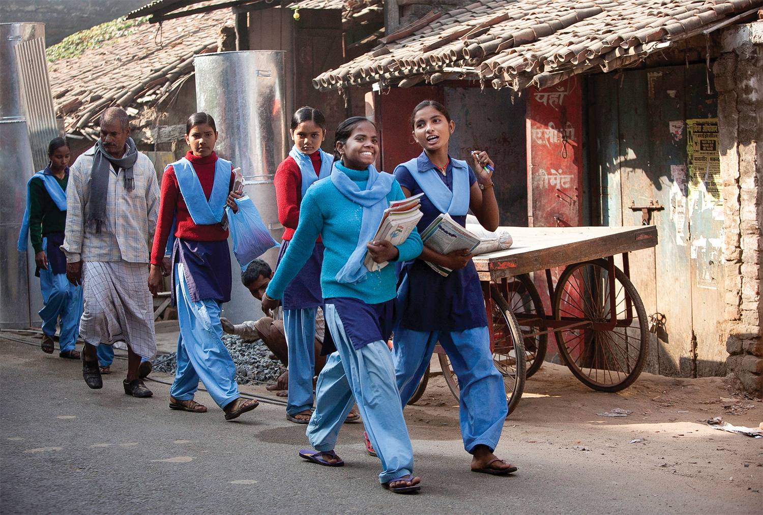 Girls walking to school through the town center in rural Bihar, 2013. (All photographs by Allison Joyce/Redux)