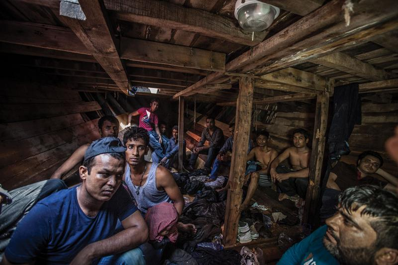 Bangladeshi and Pakistani migrants in the lower deck of a Libyan fishing boat (designed for a crew of ten) with 416 men, women, and children aboard. The boat had been at sea more than twelve hours before being intercepted by the MOAS ship the Phoenix.