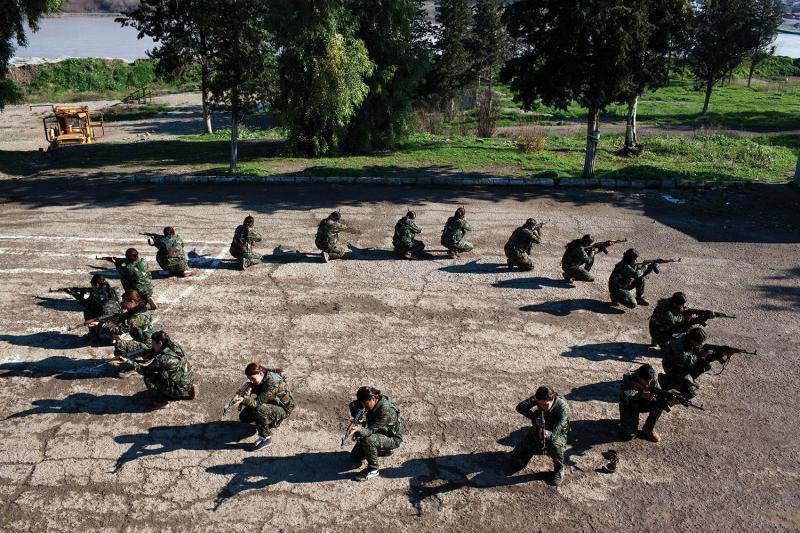 Young YPJ and YPG recruits training at the commando center in Saemalka, Jazira, Syria. (Ali Arkady/VII Mentor Program)