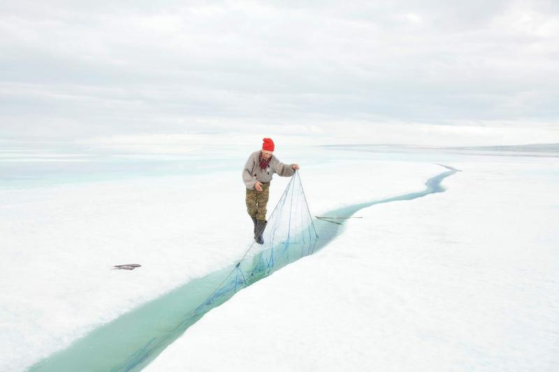 In June, the sea ice begins to crack apart, the perfect opportunity for fishing.