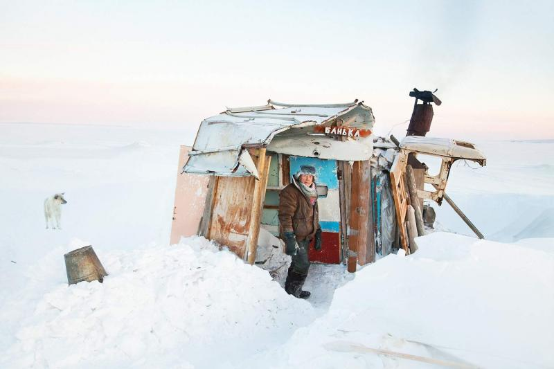A Tiksi resident known affectionately as Uncle Vanya at his bathing shack in fall and winter, 2011. The shack serves as both a retreat and study where he writes a family-values column for the local newspaper, Lighthouse of the Arctic.