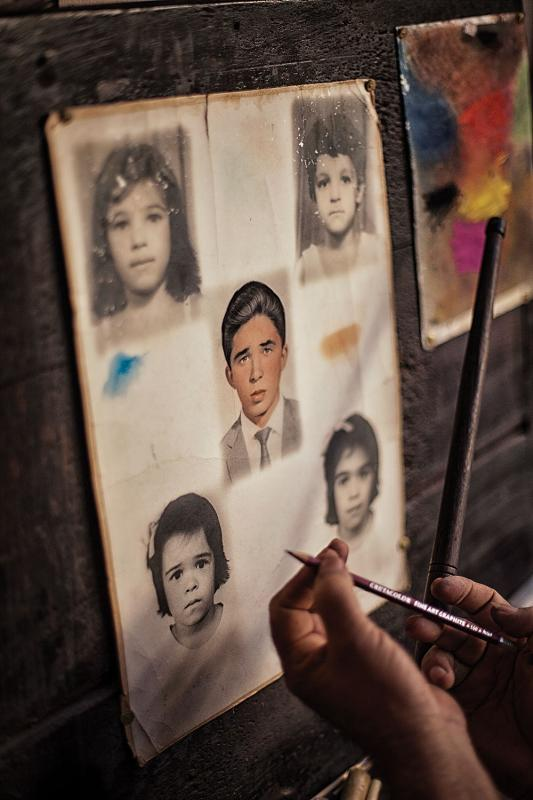 Photo painting is one of the signature traditions of northeast Brazil. Originally it involved tracing black-and-white photos onto a specialized paper, then applying color by hand. Today the work is done digitally.