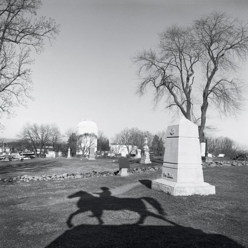 Shadow of monument to Major General Winfield Hancock.  Cemetery Hill, Gettysburg National Battlefield, Gettysburg, PA, 2012.