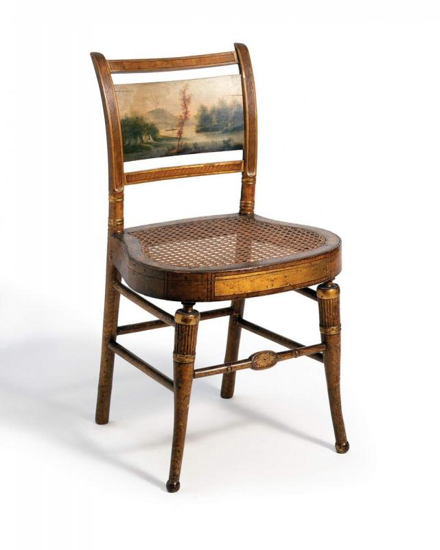 "In America, Cole often earned money by decorating so- called ""fancy"" chairs and other furnishings. Such ornamentation frequently included miniature landscapes like this one, painted on a side chair by an unknown artist, circa 1815–1825. (Courtesy of the Winterthur Museum. Bequest of Henry Francis du Pont, 1957.1075.1.)"