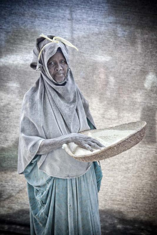 atima Mohamud Mohammad, 40 — I work as a maize husker in a milling factory. I make $80 a month, and since my husband is unemployed I have to support my nine children on my salary alone. My dream right now is simply to hold onto my job, even though the dust causes me allergy problems.