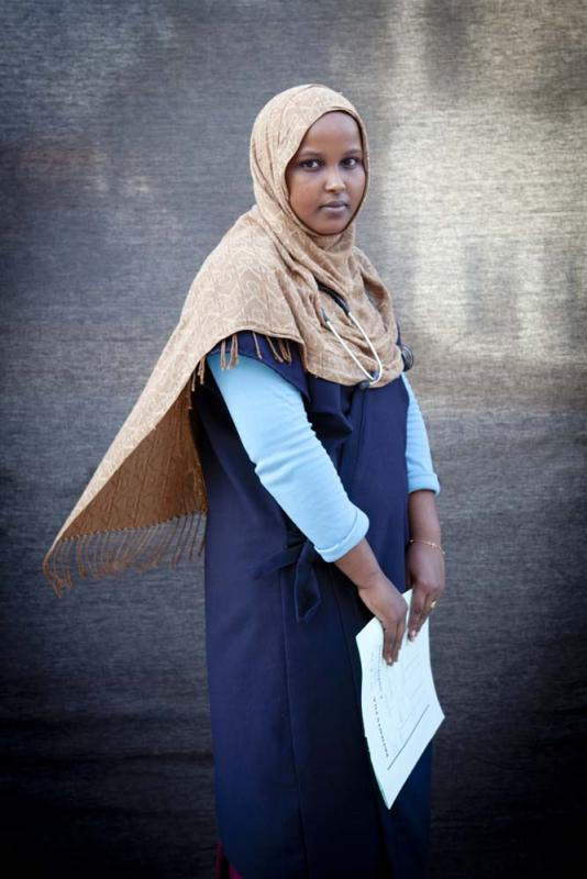 "Ayan Muhyadin, 19, Nurse — I was born in war, I work in war, and I live in war. At the clinic I mainly treat gunshot wounds and urinary tract infections. When I leave the clinic, I cover myself up, leav- ing only my eyes visible. I don't want al Shabaab to target me because I work for the government. In my free time I like to get on Facebook, read Tom and Jerry comics, and watch TV. ""Prison Break"" is my favorite show."