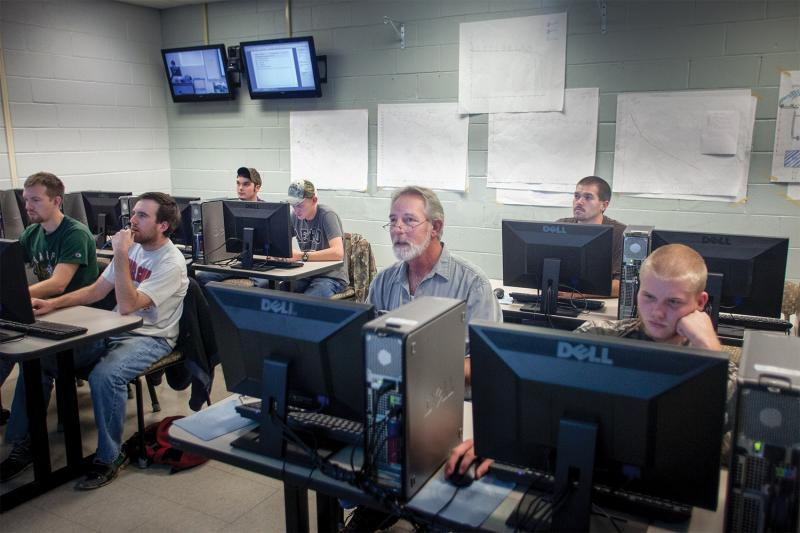 A former Philips maintenance worker, Jim Gray (center with glasses) signed up for programming classes at Motlow State Community College in McMinnville, TN, through the Trade Adjustment Assistance program.