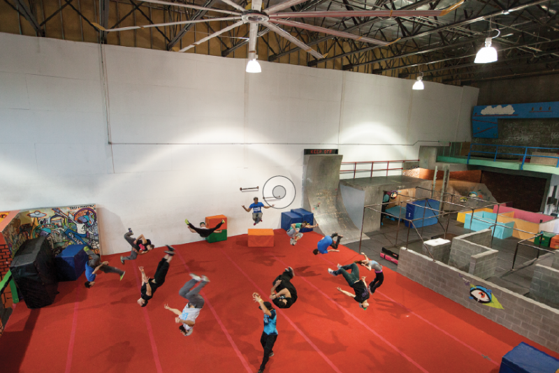 Team Tempest practices a coordinated flip at its warehouse training facility. Most members compete in free-running competitions in between performing stunts for films and commercials.