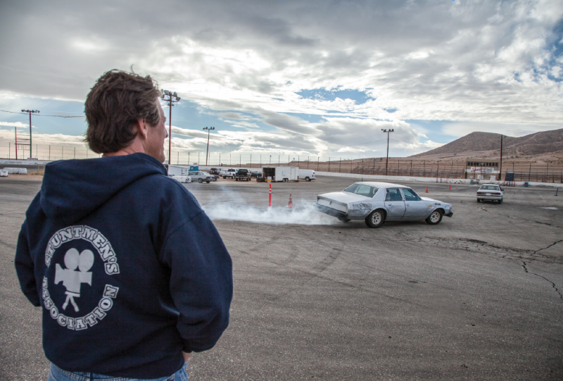 Veteran stuntman J. Mark Donaldson looks on as trainees practice stunt driving at a racetrack facility north of L.A. As president of the Stuntmen's Association, the oldest group of its kind, he keeps an eye out for upcoming talent with well-rounded stunt skills.