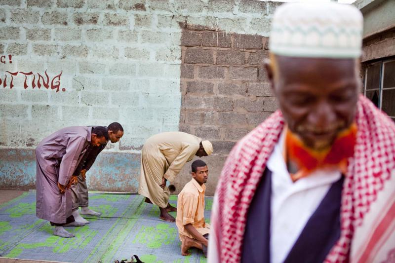 Muslim men at their afternoon prayers. Many of the older men henna-dye their beards.