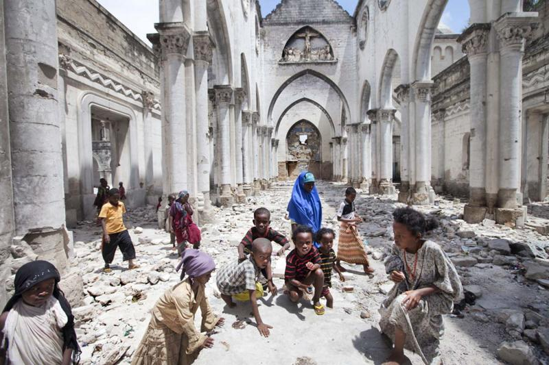Children from Al-Adala, a nearby IDP camp, play in Mogadishu Catholic Cathedral, destroyed by Islamists in 2008.