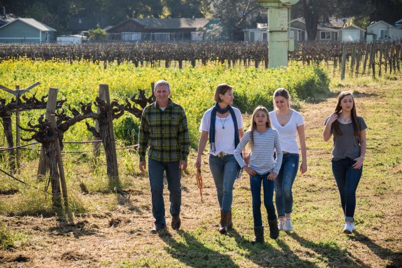 The Salvestrins at the family's twenty-year-old Cabernet Sauvignon vineyard. (©Peter Menzel / www.menzelphoto.com)