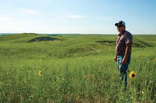Bruce Boettcher on his Sandhills ranch in July, south of Atkinson, Nebraska.