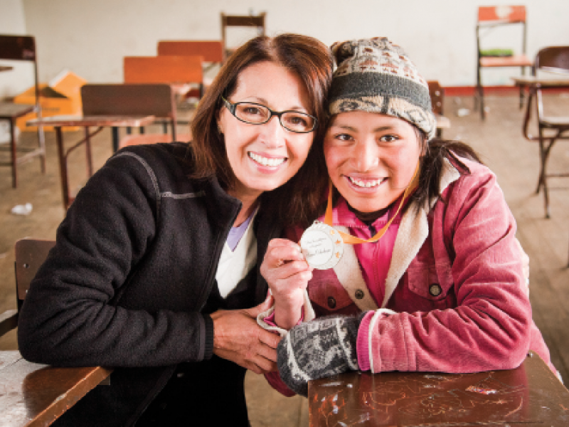 Guest Editor Marie Arana with Senna Ochochoque in the only school in the gold-mining town of La Rinconada, Peru. As Arana explains in her feature article, Senna and other girls across the globe can play a transformative role in their communities if given a chance at an education. (Photo by Gina Nemirofsky)