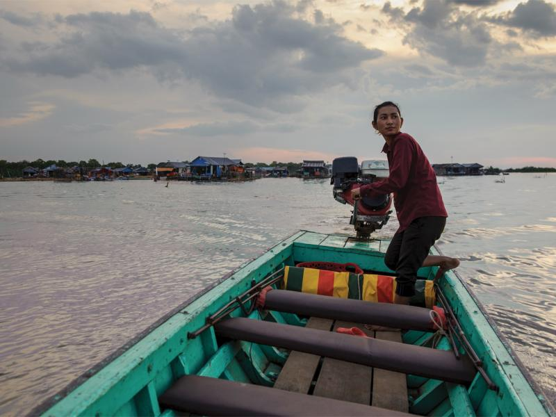 A water-taxi driver crosses the Tonle Sap lake, heading toward the mainland from the floating  village of Akol. (Luc Forsyth/Ruom)