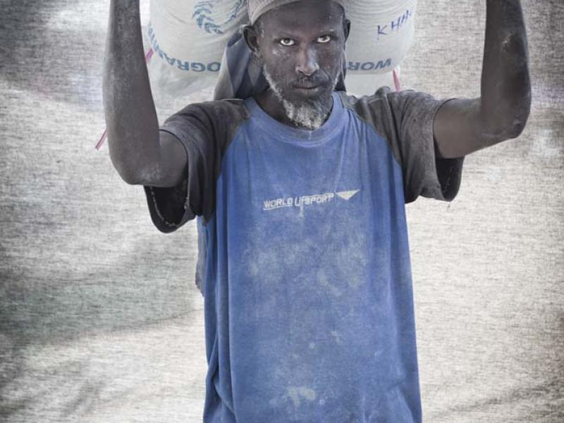 Hussein Moalim Mahdi, 50 — I'm a porter at a maize mill with a wife and six children. I can't afford to send them to school on my salary, and unfortunately I can't talk long because I only get paid for each bag I carry— ten cents per bag.