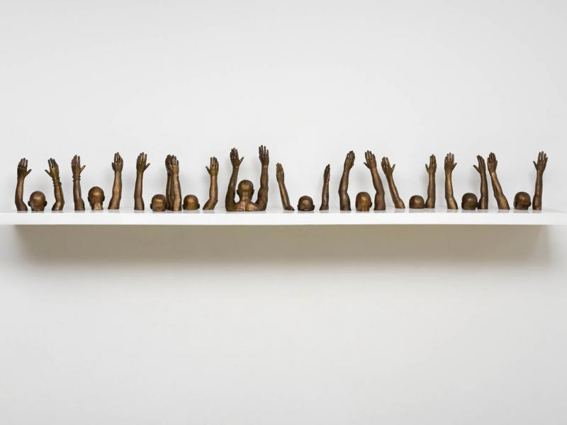 "Hank Willis Thomas, 'Raise Up,' 2014. Bronze, 112.2 X 9.84"". (Courtesy of the artist and Jack Shainman Gallery, NY.)"