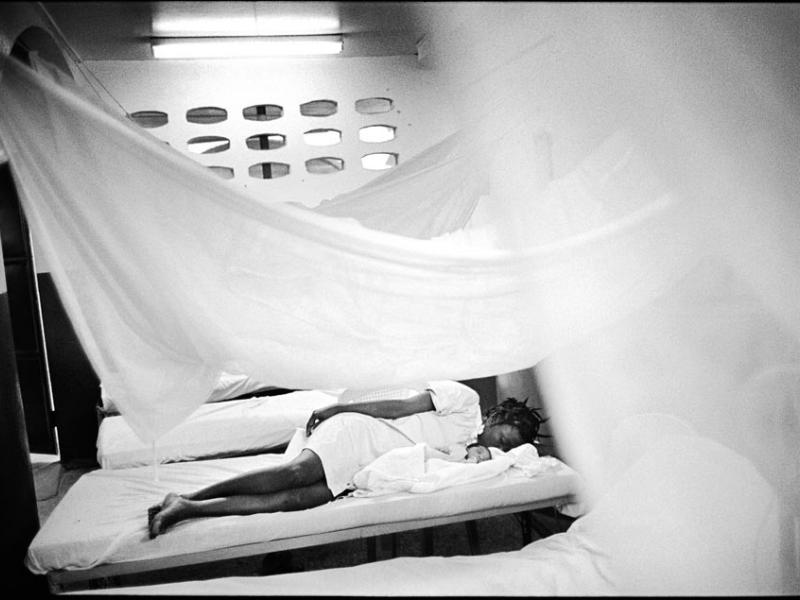 A young mother rests under mosquito nets with her newborn baby in one of the four Doctors Without Borders clinics in Port-au-Prince. The humanitarian organization tries to fill in gaps left by the capital city's virtually nonexistent healthcare system.