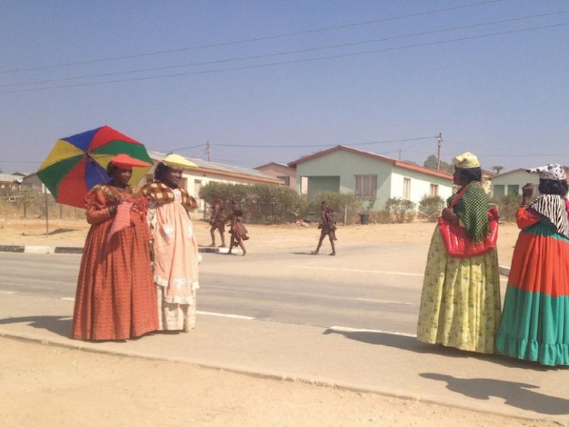 Herero and Himba women, cousins distanced by Namibia's colonial legacy, display easy kinship on the streets of Opuwo. Photo by Catherine E. McKinley.