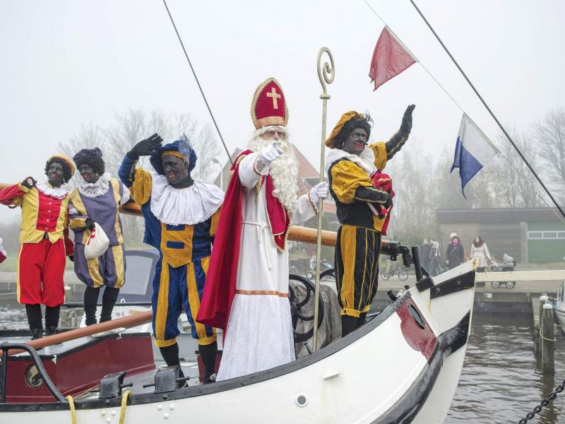 The arrival of Sinterklaas (Saint Nicholas) and Zwarte Piet (Black Pete) in a Frisian village in the Netherlands on November 24, 2012. (Patrick Post / Hollandse Hoogte)