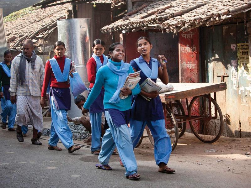 Girls walking to school through the town center in rural Bihar, 2013. (All photographs by Allison Joyce/Redux)