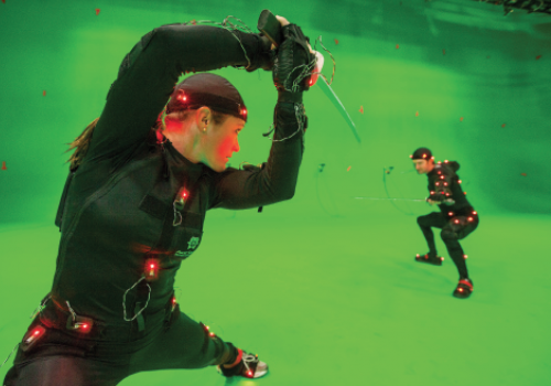 "Stuntwoman Luci Romberg practices a sword-fighting scene in a motion-capture suit for a forthcoming project at Universal Studios. Defined as the 3D representation of a live performance, ""mocap"" allows engineers to digitally manipulate the movement of actors and backgrounds with almost unlimited freedom."